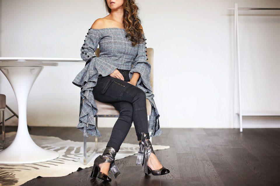 Janet Mandell of Fashionaholic wearing gray plaid Storets ruffle top